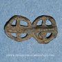 Coins Gaule. Chapelet de deux rouelles à quatre rayons. Plomb. 9,21 x 17,32 mm