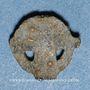 Coins Rouelle celte en plomb à quatre rayons. 10,09 mm