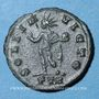 Coins Constantin I (307-337). 1/4 follis. Trèves, 1ère officine, 310-311. R/: le Soleil debout. Inédit (?)