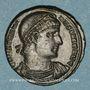 Coins Constantin I (307-337). Follis. Constantinople, 1ère officine, 328. R/: Victoire assise à gauche