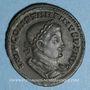 Coins Constantin I (307-337). Follis. Lyon, 1ère officine, 310-311. R/: le Soleil radié