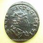 Coins Constantin I (307-337). Follis. Trèves, 310-313. R/: buste radié du Soleil à droite