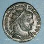 Coins Dioclétien (284-305). Bronze radié. Héraclée, 4e officine, 295-298. R/: Dioclétien debout à droite