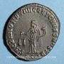 Coins Dioclétien (284-305). Follis. Ticinum, 1ère officine, 300-303. R/: la Monnaie debout à gauche